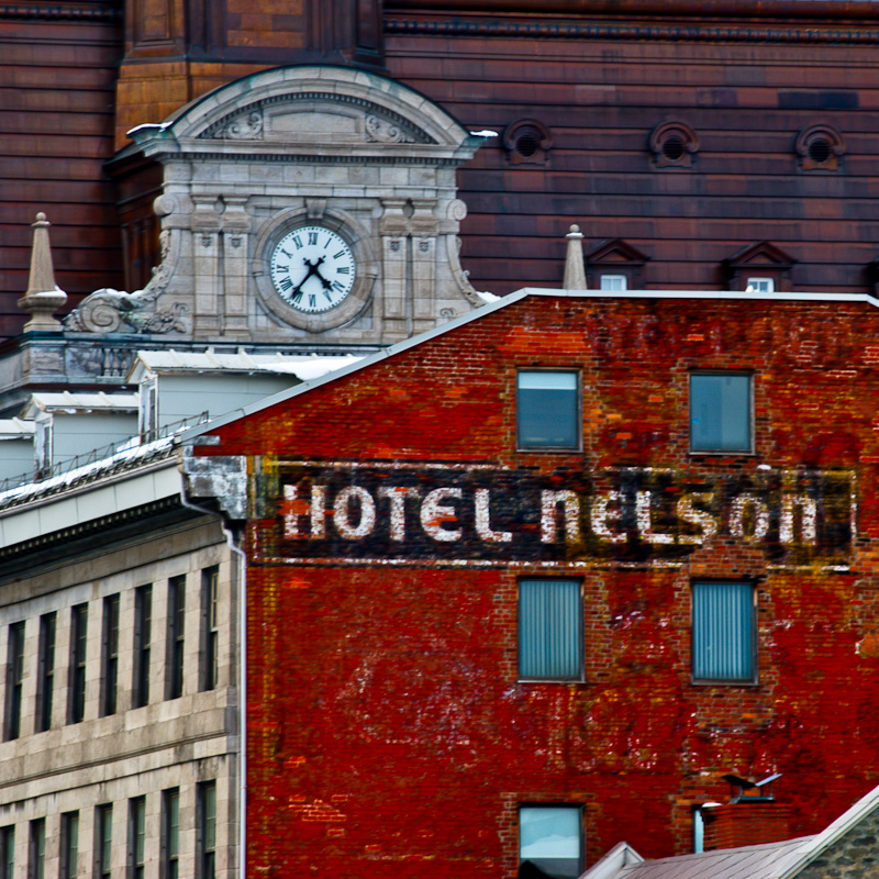 City Hall Clock with Hotel Nelson in the foreground