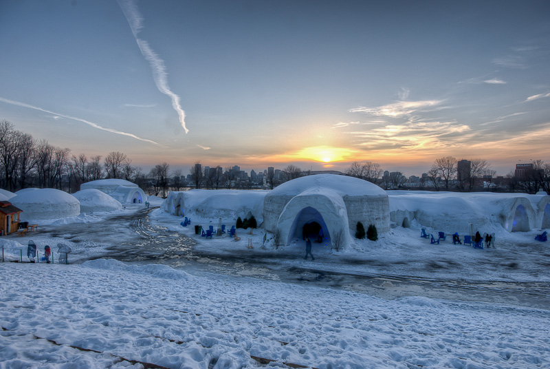 Montreal Ice Hotel with skyline of Montreal at sunset