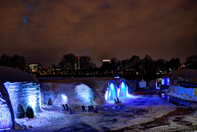 Canada Snow Village at night with Montreal skyline