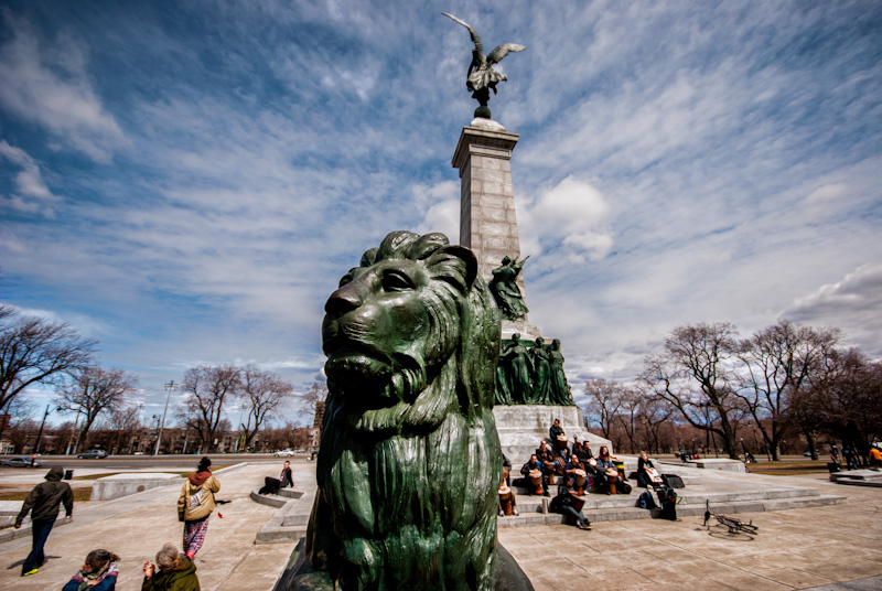 A Lion keeps guard over the Tam Tams at the George Étienne Cartier Monument