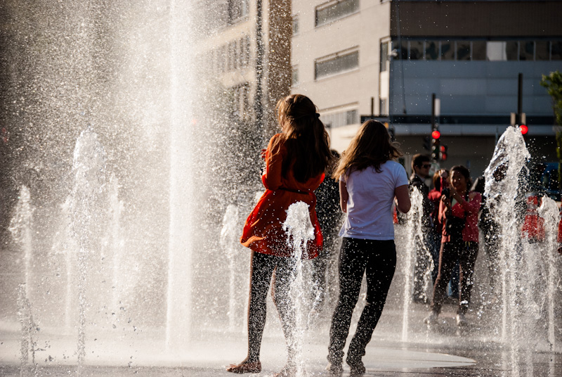 Friends playing in the Place des Festival fountains