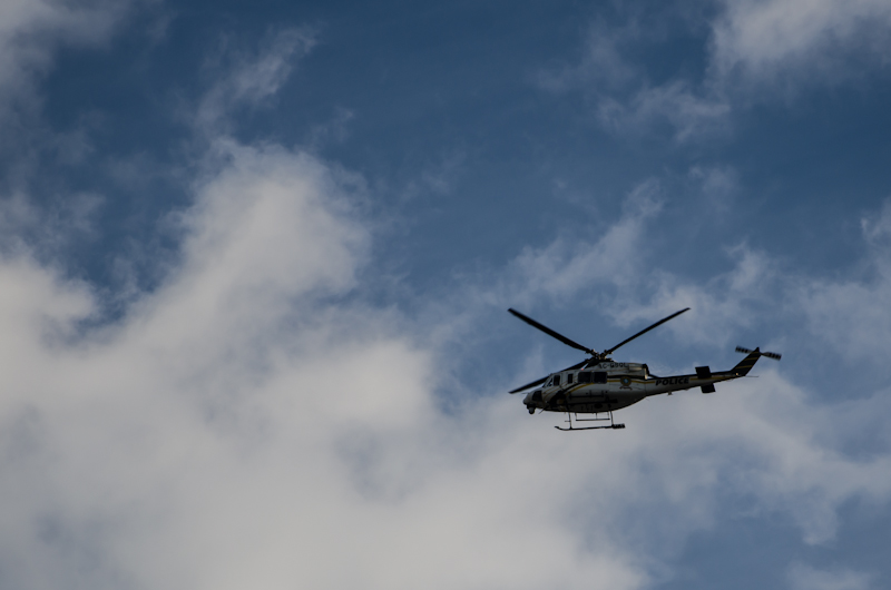 The drone of the Police Helicopter competing with the music
