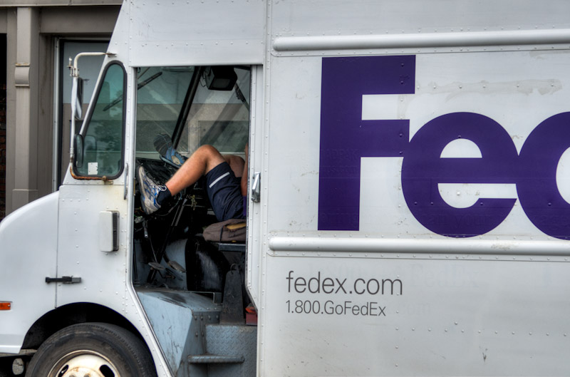 FedEx driver with his feet up