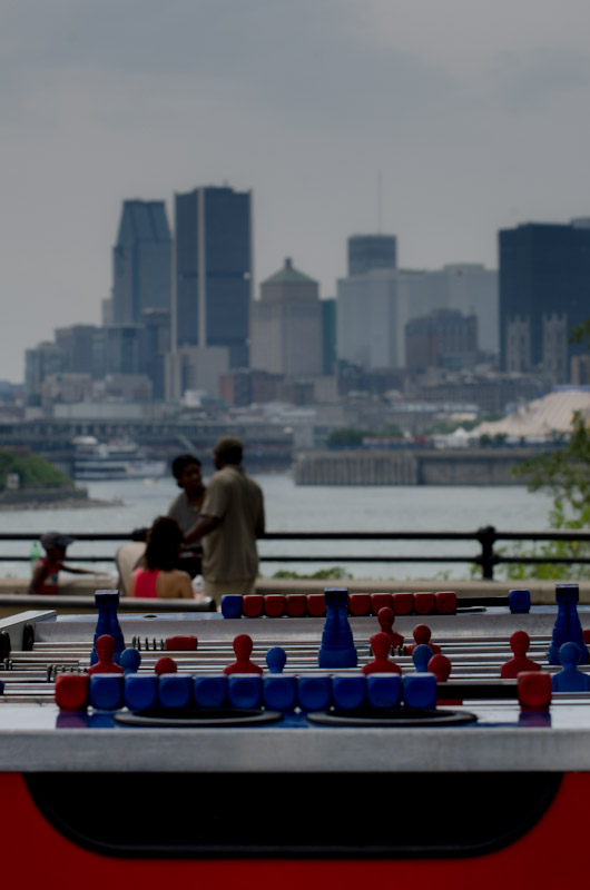 Foosball beneath Montreal skyline