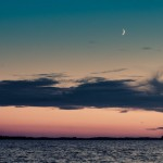 Sunset with new moon over Macamic Lake