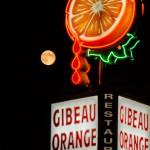 Moon rising against the Orange Julep sign