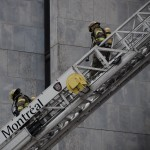 Firefighters descend ladder