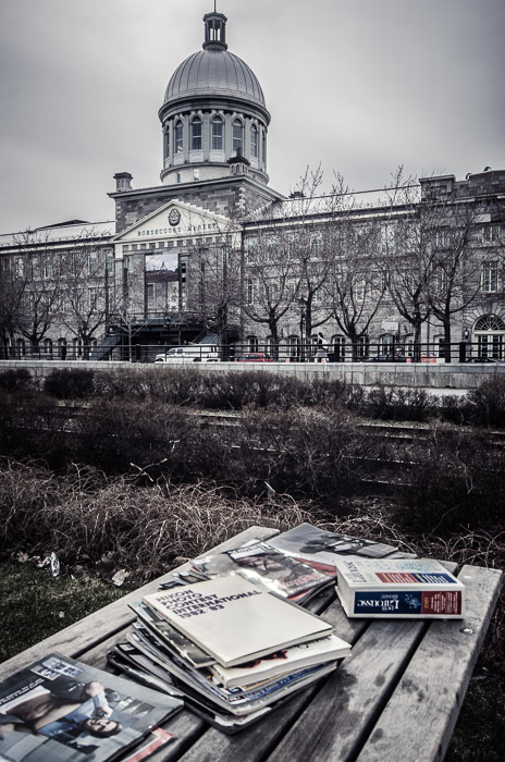 Reading beside Marché Bonsecours