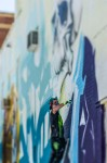 Alex Scaner working on his mural