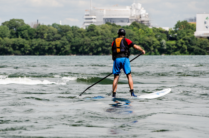 Paddle boarder approaches the rapids