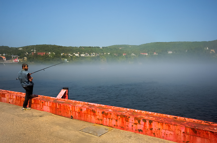 Fisherman on the Tadoussac pier